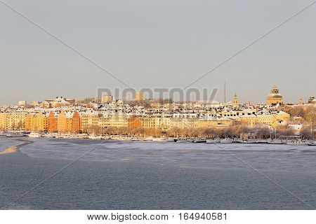 STOCKHOLM - JAN 08 2017: Norr Malarstrand and boats in central stockholm a sunny cold winter morning ice on the sea. January 08 2017 in Stockholm Sweden