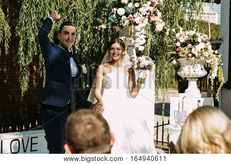 Couple Holds Each Other Hands On The Ceremony