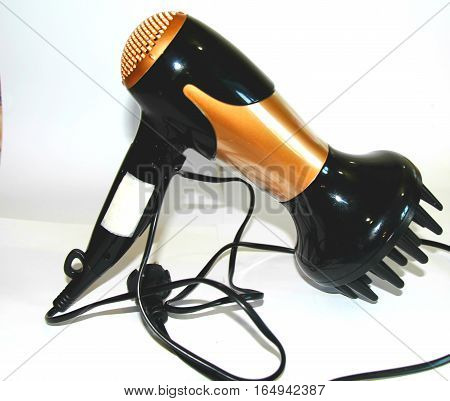 Hairdryer for hair styling. Hairdryer for styling hair after a shower. Very comfortable. Makes hair beautiful and shiny. German quality.