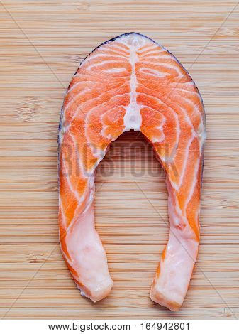 Fresh Salmon Fillet Sliced Flat Lay On Bamboo Cutting Board. Fresh Salmon Fillet Sliced Tempts Buyer