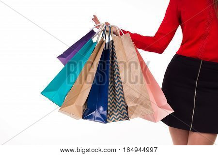 Multicolored And Bright Shopping Packages Hanging On Female Right Hand