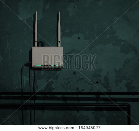Wi-Fi router on an old wall in a dark room