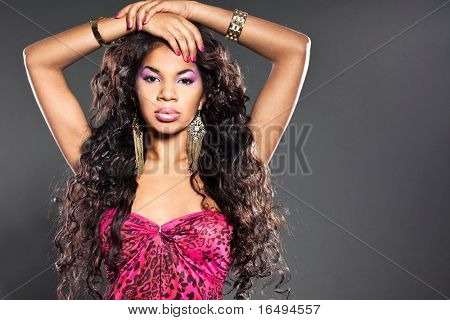 Elegant mulatto girl with long hair