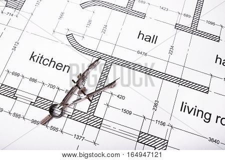 Construction of the building layout, building drawing on paper, steel compasses for drawing