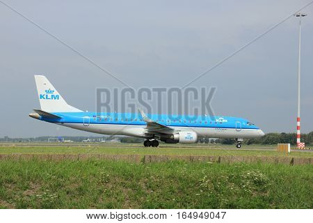Amsterdam The Netherlands - August 10 2015: PH-EZS KLM Cityhopper Embraer ERJ-190 taxing on the Polderbaan runway to the main terminal of Amsterdam Schiphol Airport
