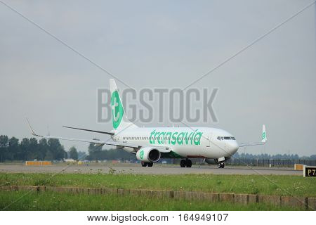 Amsterdam The Netherlands - August 10 2015: PH-HZE Transavia Boeing 737-800 taxing on the Polderbaan runway to the main terminal of Amsterdam Schiphol Airport