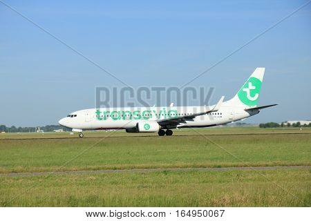 Amsterdam the Netherlands - June 9th 2016: PH-HZW Transavia Boeing 737 take off from Polderbaan runway Schiphol destination Porto Portugal