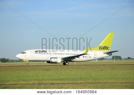Amsterdam the Netherlands - June 9th 2016: YL-BBL Air Baltic Boeing 737-33V(WL) takeoff fro Polderbaan runway destinationRiga Latvia