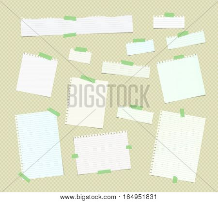Ripped white ruled note, notebook, copybook paper sheets, strips stuck with green sticky tape on squared pattern.