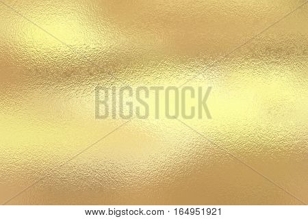 Shining gold foil. Yellow metallic texture background.