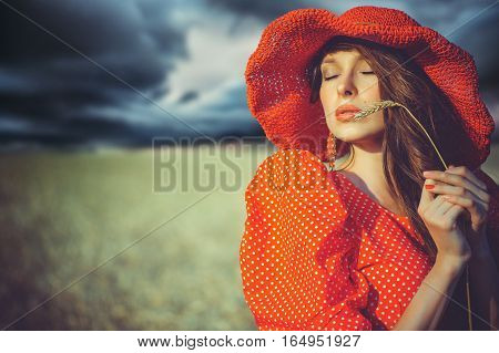 Beautiful Woman In A Red Hat