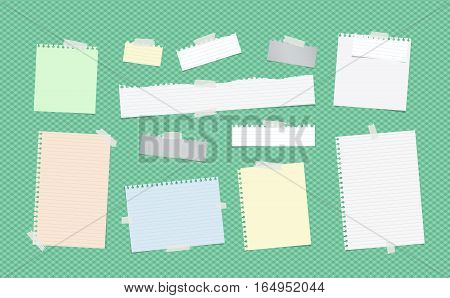 Ripped colorful ruled note, notebook, copybook paper sheets, strips stuck with white sticky tape on green squared pattern.