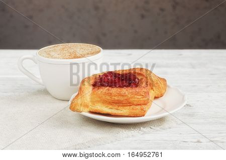 Fruit Dessert And Coffee On A Wooden Table