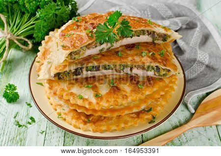 Meat with mushrooms cheese and herbs baked in crispy dough