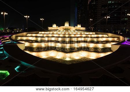 Night view of colorful fountains in Abu Dhabi, United Arab Emirates.