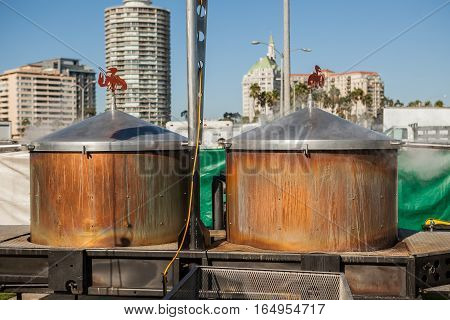 Huge street pots for boiling lobsters on a food lobster festival
