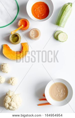 cooking vegetable puree for baby on white background top view.