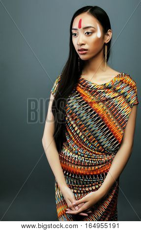 beauty young asian girl with make up like Pocahontas, red indians woman fashion, close up beauty vietnamese