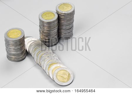 Thai baht money or Money thai coins staircase sorted on isolate on gray table. King of Thailand. The concept of financial planning, savings, Busines successful
