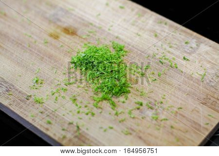 Fresh lime zest on the wooden board