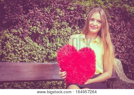 Enamored Woman With Big Red Heart