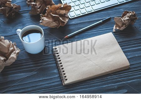 concept of writer desktop on wooden background top view mock up
