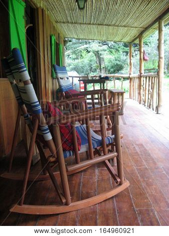 Rocking chairs on the porch of a cabin