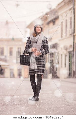 Young Woman Winter Snowing Looking Above