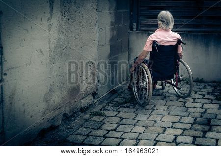 Senior man in wheelchair, isolation and loneliness concept