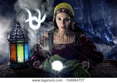 Psychic or fortune teller with crystal ball and horoscope zodiac sign of Ophiuchus