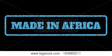 Light Blue rubber seal stamp with Made In Africa text. Vector caption inside rounded rectangular frame. Grunge design and dirty texture for watermark labels. Horisontal sticker on a black background.