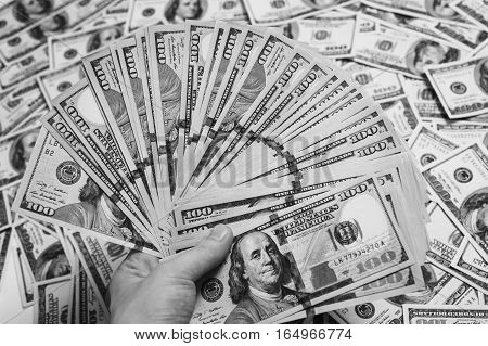 fan of money a fan of new hundred dollar bills hundred dollar bills face thirst for wealth detail renting pocket money money background Millionaire