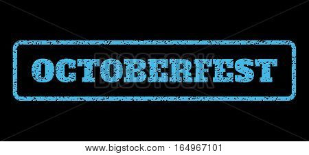 Light Blue rubber seal stamp with Octoberfest text. Vector message inside rounded rectangular shape. Grunge design and dust texture for watermark labels. Horisontal emblem on a black background.