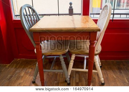 Vintage wooden kitchen chair and table, stock photo