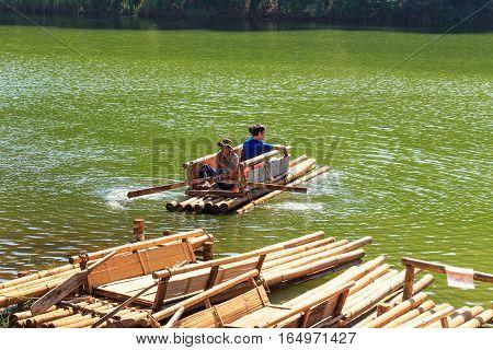 Traveler Relaxing On Bamboo Raft In Brigt Lake