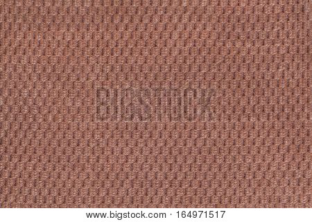 Dark brown background from soft fleecy fabric closeup. Texture of textile macro.