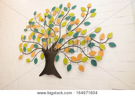 Beautiful wall decoration with colorful leaves tree stock photo