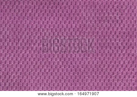 Light purple background from soft fleecy fabric closeup. Texture of textile macro.