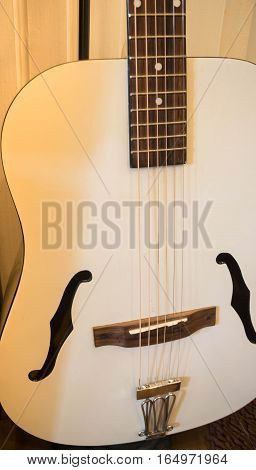 Accoustic guitar in the room stock photo