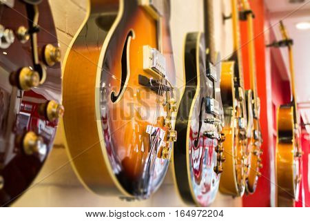 Beautiful sunburst electric guitar in the shop stock photo