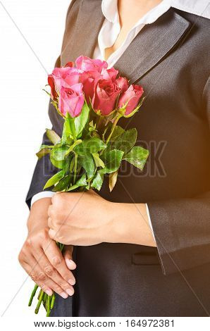 Business woman holding roses over white background
