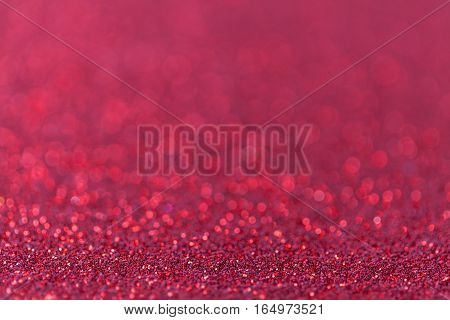 Red sparkling background from small sequins closeup. Brilliant and diamond backdrop.