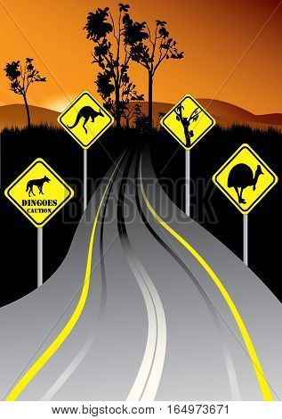 Australian road signs beside the road in the sunset