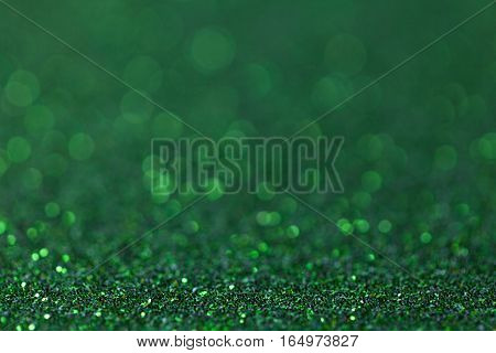 Dark green sparkling background from small sequins closeup. Brilliant and diamond backdrop.
