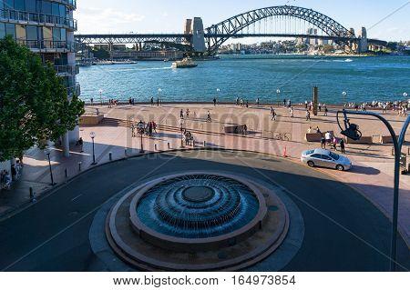 Allen Lewis Fountain With Sydney Harbour Bridge In Circular Quay