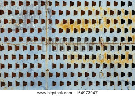 Pentagon Shape Holes In Greay Metal Sheet Abtract Texture Background