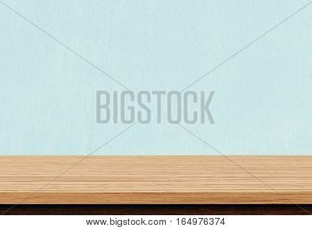 Empty Brown Wood Table Top On Blue Concrete Background, Used For Display Or Montage Your Products.