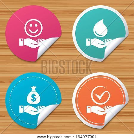 Round stickers or website banners. Smile and hand icon. Water drop and Tick or Check symbol. Palm holds Dollar money bag. Circle badges with bended corner. Vector