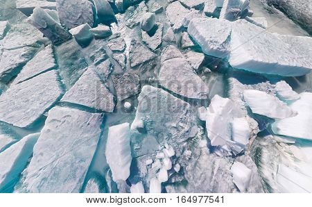 Texture background ice cracks and hummocks of Baikal.