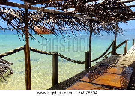 Wooden pier at Pangaimotu island near Tongatapu in Tonga. Kindom of Tonga is an archipelago comprised of 169 islands